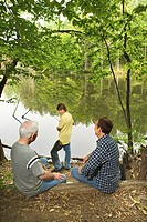 Generations of men by lake