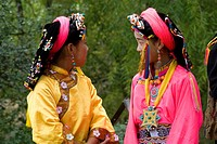 China, Sichuan, near Danba, Tibetan village festival, youg girls in colored traditional costume