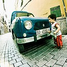 Toddler in front of old Renault, Ciutadella. Minorca, Balearic Islands, Spain