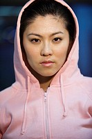 Young Woman in a Pink Hooded Sweatshirt