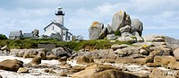 Lighthouse on the coast between rocks in Finistere in Brittany in France