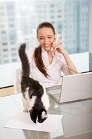 business woman using computer and telephone