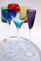 Silver tray with tall coloured liquer glasses