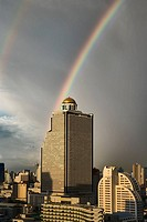 Double rainbow over Bangkok and the State Tower, Bangkok, Thailand  The famed Sirocco Restaurant is located at the top of this tower  Vantage point is...