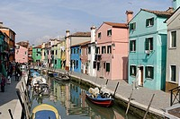 Colourfully painted houses along a canal in Burano, an island in the Venetian Lagoon, Italy, Europe