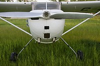 Piper cub light aircraft with aluminium propeller at airstrip in Alberta. Canada