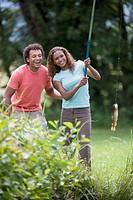 Mixed race couple fishing
