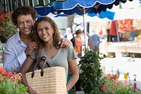 Mixed race couple shopping at outdoor market