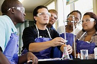 Students performing experiment in chemistry lab