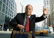 African businessman hailing taxi cab