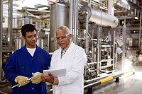 Scientist talking to factory worker