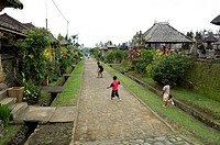 Traditional village, main street, children, in Bangli, Bali, Indonesia