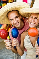 Couple shaking maracas in store