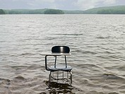 A desk and chair in a lake
