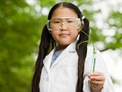 A girl holding a test tube
