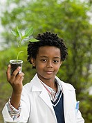 A boy holding a plant in a volumetric flask