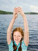 A girl holding a volumetric flask