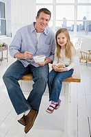 Father in kitchen with daughter