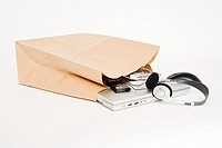 Electrical goods in a paper bag