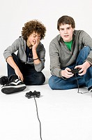 Teenage boys playing video game