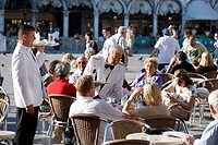Waiters and guests on a terrace, Café Florian, St. Mark's Square, Venice, Venezia, Italy, Europe