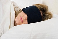 Woman sleeping with eye mask on (thumbnail)