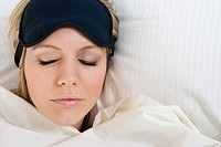 Sleeping woman wearing eye mask