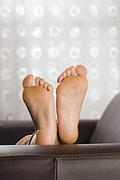 Feet on sofa