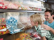 A father and son choosing sweets