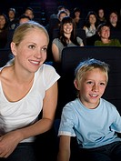A mother and son watching a movie