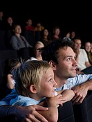 A father and son watching a movie