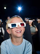 A boy watching a 3d movie