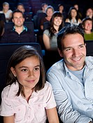 Father and daughter watching a movie