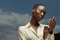 African businesswoman text messaging