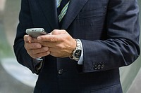 Businessman using a handheld computer
