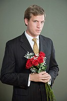 Portrait of a man holding a bouquet of roses