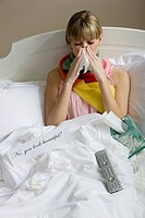 A woman in bed with a cold (thumbnail)