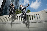 Businessmen jumping