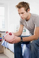 Student with piggy bank
