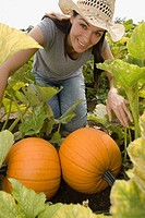 Woman picking pumpkins