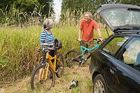 Couple with car and bicycles