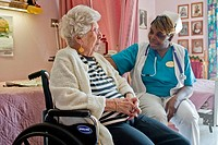 A nurse talks to a nursing home resident