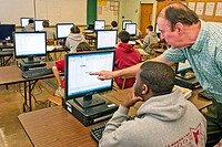 Students at Trinity Catholic High School use state-of-the-art computers and drafting software now thanks to a grant from Emerson. Gene Schnell teaches...