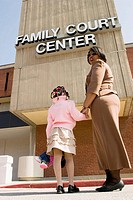 Angela Bell is a CASA, Court Appointed Child Advocate, volunteer, in front of the Family Court Center in Clayton with a child modeling for this illust...