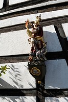 Statue of a saint on the wall of a half timbered building in Langenleiten, Gemeinde Sandberg, Rhoen Mountains, Lower Franconia, Bavaria, Germany, Euro...