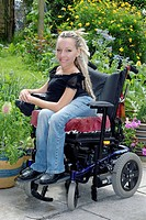 Woman with spinal muscular atrophy in wheelchair. Spinal muscular atrophy SMA is a genetic disease which causes the degeneration of motor neurones in ...
