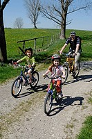 Family on a bicycle ride near Koenigsdorf, Upper Bavaria, Germany, Europe
