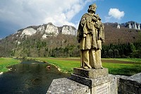 Stone statue of a saint on a bridge, Upper Danube near Hausen im Tal, Baden-Wuerttemberg, Germany, Europe