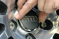 Setting an AUDI logo in the wheel rim during final assembly of an Audi A8, production for A4, A6 and A8 models, Audi AG, Neckarsulm, Baden-Wuerttenber...