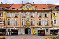 Ornate building facade behind the market stalls on the Main Square of St. Veit, Carinthia, Austria